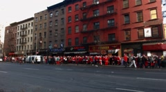 A very wide shot of 3rd avenue shows hundreds of young men and women Stock Footage