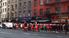 A very wide shot of 3rd ave shows hundreds of men and women Stock Footage