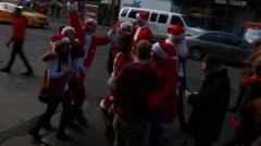 Many seemingly drunk young men and women dressed as Santa Claus Stock Footage
