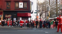 A very wide shot of hundreds of young men and women dressed as Santa Claus Stock Footage