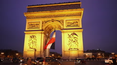 Triumphs arch called Arc de Triomphe with French flag in the evening Stock Footage