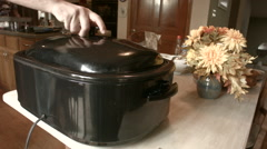 cooked turkey in the turkey cooker - stock footage