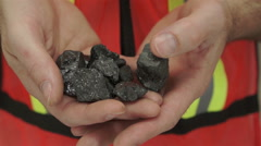 Miner Shows Carbon Graphite Ore Stock Footage