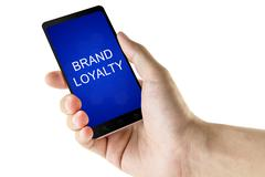 Brand loyalty word on digital smart phone Stock Photos