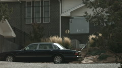 Brick house with a jag out front Stock Footage