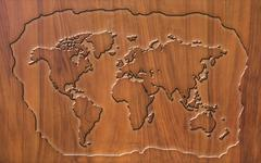 world map carving on wood board - stock illustration