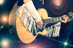 woman guitarist in the country band - stock photo