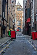 Looking down an empty inner city alleyway Stock Photos