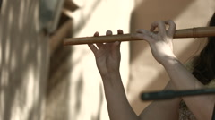 Women playing a irish flute Stock Footage
