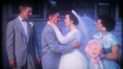 1393 - newlyweds kissing on their wedding day - vintage film home movie - stock footage