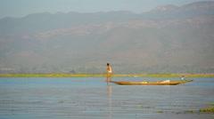 Inle lake, myanmar - circa jan 2014: man rowing with your foot Stock Footage