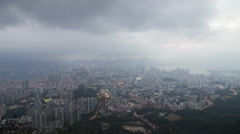 Hong kong buildings on mountain with white clouds Stock Footage