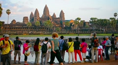 angkor, cambodia - circa dec 2013: crowd of tourists bustling about the groun - stock footage