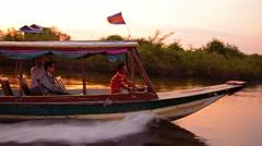 Tonle sap lake, cambodia - circa dec 2013: local boatman cruising quickly dow Stock Footage