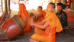 Siem reap, cambodia - circa dec 2013: young monks playing music on traditiona Stock Footage