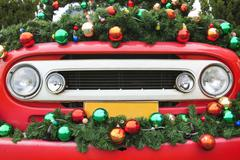 front view of ol vntage truck decorated with cristmast and new years accessor - stock photo
