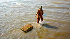 sihanoukville, cambodia - circa dec 2013: local fisherman in bright clothes c - stock footage
