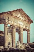 remaining of the roman city of dougga with the capitol, tunisia - stock photo