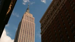 Sunny empire state building 4k time lapse from new york Stock Footage