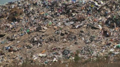 mountain of garbage waste plastic bottles packages of rotting food - stock footage