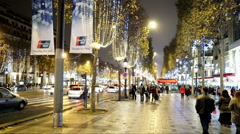 People walking through Champs Elysees Avenue in Paris Stock Footage