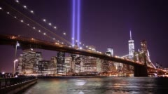 Brooklyn bridge night light towers of light 4k time lapse from new york city Stock Footage