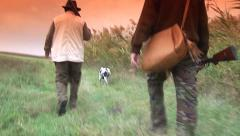 Hunters with dog on the field Stock Footage