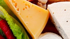 Delicatessen types of cheese on wooden board Stock Footage
