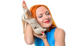 Woman with High heel shoe - stock photo