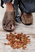 Poor and coins Stock Photos