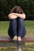 Teenager lonely depressed and sadness in a park Stock Photos