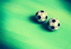 Two toy soccer balls Stock Photos
