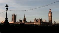 London - Big Ben clock strikes the hour as commuters go to work Stock Footage