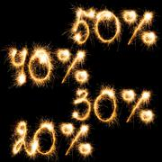Sparkling inscription of 50%, 40%,30%, 20% on a black Kuvituskuvat