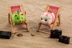 Piggy bank in a deck chair Stock Photos