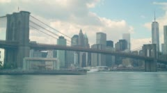 cloudy day manhattan view through brooklyn bridge 4k time lapse from new york - stock footage