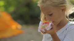 Little blond girl eating a beautiful cake with fruit Stock Footage