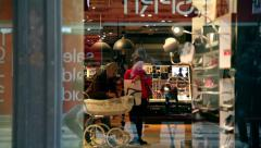 Baby carriage in a makeup store Stock Footage