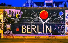 the berlin wall (berliner mauer) with grafitti - stock photo