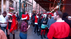 Men and Women dressed as Santa Claus during the annual Santa-Con event Stock Footage