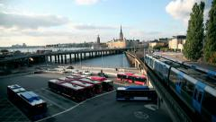 Trains and buses in a metropolitan bus terminal Stock Footage