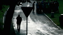 Silhouette people walking in a park in different directions  Stock Footage