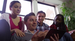 4K Cheerful group of young friends hanging out together with computer tablet - stock footage