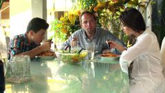 Happy family talking and eating spaghetti at home HD Stock Footage