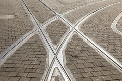 Stock Photo of rails of streetcar in old cobble stone street