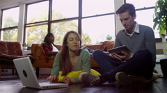 4K Group of students studying and relaxing together with technology - stock footage