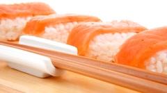 Set of nigiri sushi on wooden board Stock Footage