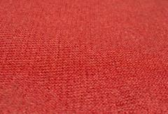 Red wool knitwork selective focus perspective - stock photo