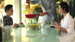 Family preparing meal and putting spaghetti on plates at home HD Stock Footage