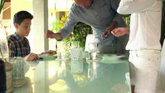 Family preparing and putting plates and cutlery on table at home HD Stock Footage
